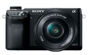 "The NEX line of Sony cameras aren't much bigger than a typical ""point-and-shoot"" camera."